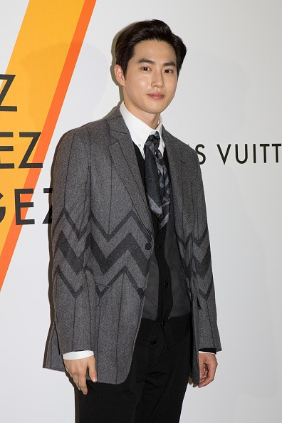 EXO member Suho in attendance during a Louis Vuitton exhibition in Japan.