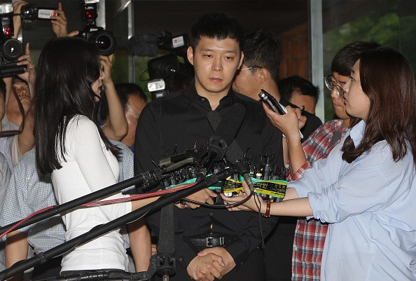 """""""Lucid Dream"""" actor Park Yoochun faces the media after investigation of alleged rape case."""