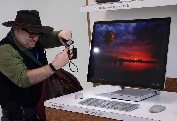 A man gets a look at the new Microsoft Surface Studio introduced at a Microsoft news conference  October 26, 2016 in New York.