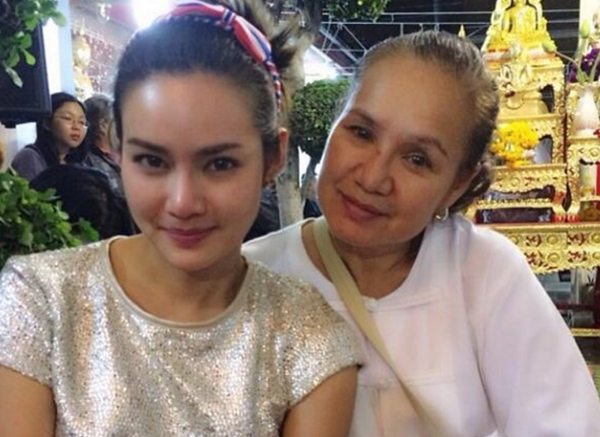 """Thai singer and actress Yayaying Rhatha Phongam, who stars with Jason Statham and Michelle Yeoh in """"Mechanic: Resurrection,"""" poses with her mother."""