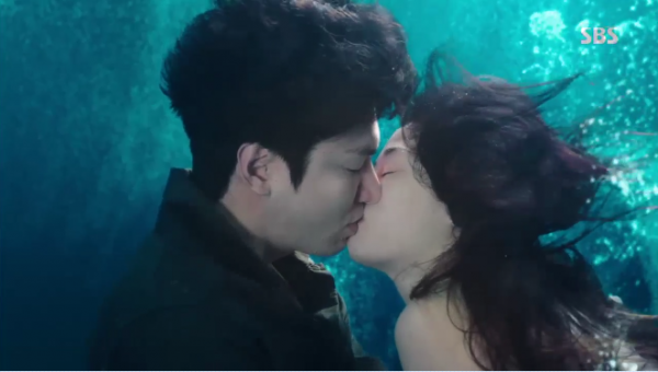 """Lee Min Ho and Jun Ji Hyun kissing in a scene from """"The Legend of the Blue Sea."""""""