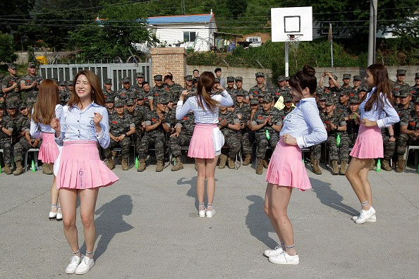 LABOUM members perform in front of the marine members of South Korea.