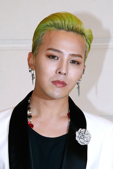Singer Kwon Ji-Yong alias. G-Dragon attends the 'Chanel Collection des Metiers d'Art 2016/17 : Paris Cosmopolite' : Photocall at Hotel Ritz on December 6, 2016 in Paris, France.