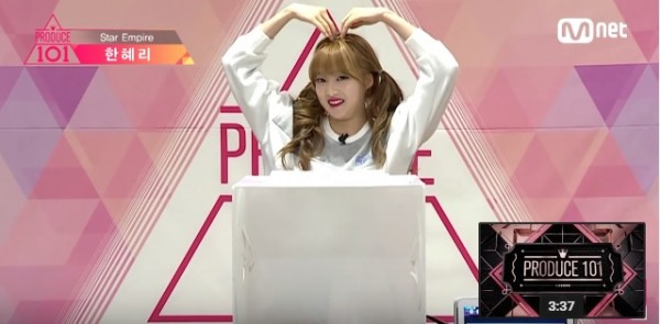 """Han Hyeri poses after conquering a challenge on Mnet's """"Produce 101."""""""