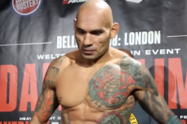 Evangelista 'Cyborg' Santos weighs in before his face-off with Michael 'Venom' Page in Bellator 158