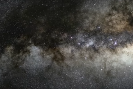 The Milky Way galaxy at night, with a super massive black hole at its center that spits out planetoids from shredded stars.