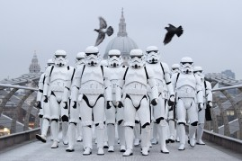 """People dressed as Stormtroopers from the Star Wars franchise of films posed on the Millennium Bridge to promote the latest release in the series, """"Rogue One,"""" on Dec. 15, 2016 in London, England."""