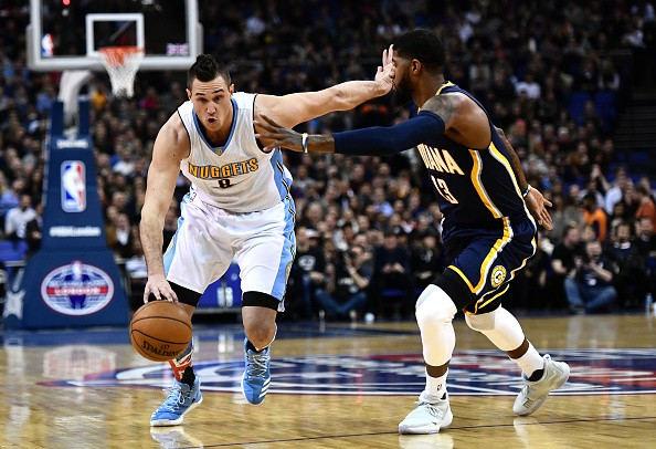 Danilo Gallinari of the Denver Nuggets holds of Paul George of the Indiana Pacers during the NBA match between Indiana Pacers and Denver Nugget in London, England.