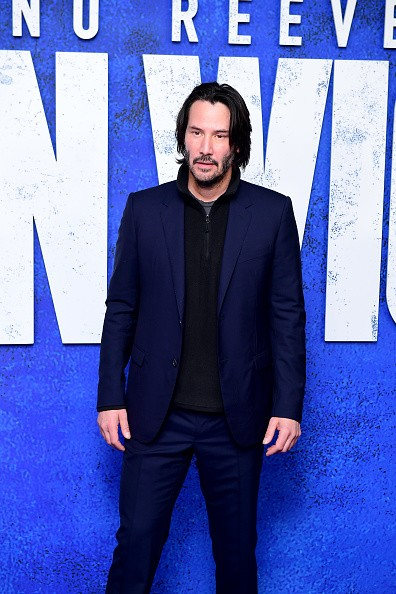 "The image features Keanu Reeves, the star of the ""John Wick"" movie."