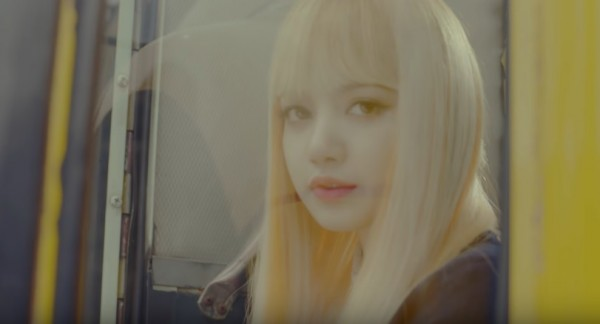 "BLACKPINK's Lisa in the official music video of ""Playing With Fire."""