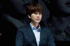 Kyuhyun of South Korean boy band Super Junior attends the press conference for SM Entertainment's Super Junior 10th Anniversary Special Album 'Devil' at SMtown Theatre on July 15, 2015 in Seoul, South Korea.