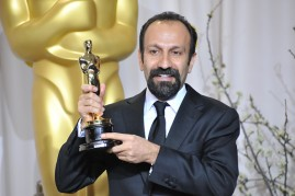 """The image features Filmmaker Asghar Farhadi as he holds the """"84th Annual Academy Awards"""" Best Foreign Film Award for """"A Separation""""."""