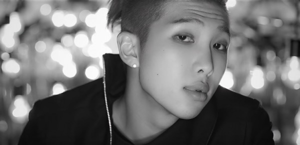 """BTS member Rap Monster in the official music video of """"Do You."""""""