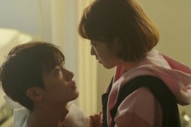 Park Hyung Sik (L) and Park Bo Young (R) getting cozy in an episode of 'Strong Woman Do Bong Soon.'