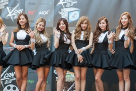Girls' Generation members pose upon arrival at the KCON 2014.