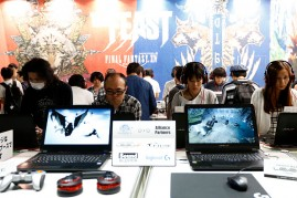 Visitors play the Final Fantasy XIV in the Square Enix Co. booth at Tokyo Game Show on Sept, 17, 2016 in Chiba, Japan.